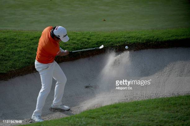 Poom Saksansin of Thailand plays a bunker shot on the 16th hole during Day Two of the Maybank Championship at Saujana Golf and Country Club on March...
