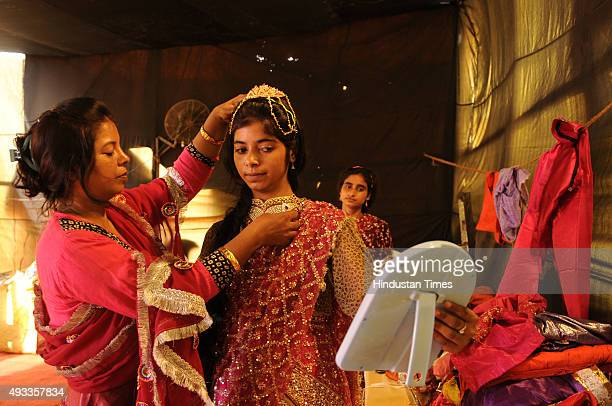 Poonam Khan Kashish and Farah Khan who play the roles of KaiKai Sabri and Suparnkha get ready backstage during Ramleela on October 19 2015 in Greater...