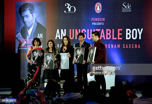 Poonam Saxena Milee Ashwarya and Shobhaa De with Shah Rukh Shah as he launches Karan Johar's book 'An Unsuitable Boy' written by the filmmaker and...