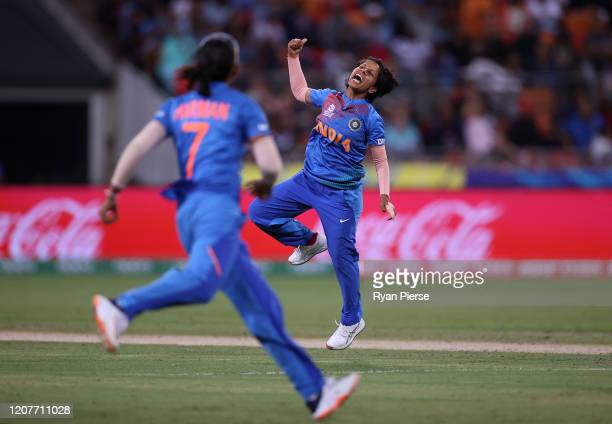 Poonam Yadav of India celebrates after taking the wicket of Alyssa Healy of Australia during the ICC Women's T20 Cricket World Cup match between...