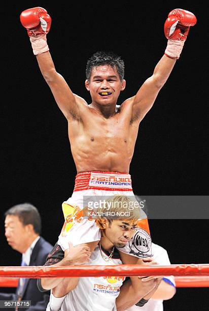 S SURNAME SPELLING Poonsawat Kratingdaeng of Thailand celebrates his victory over Japan's Satoshi Hosono in their WBA super bantamweight title match...