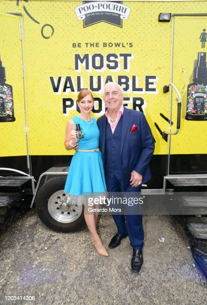 Poo-Pourri Spokeswoman Bethany and Ric Flair let it go during Poo-Pourri's Giant Poo In Miami at The Wynwood Marketplace on February 01, 2020 in...