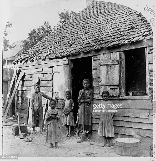 Poor African American Children Standing by Cabin