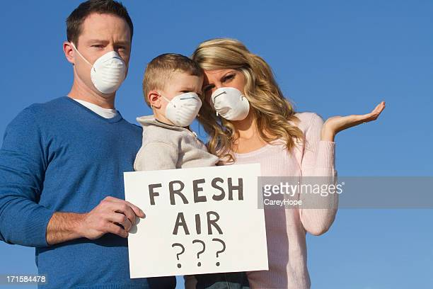 poor air quality and pollution concept - air respirator mask stock pictures, royalty-free photos & images