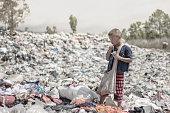 Poor children earn money by selling garbage.