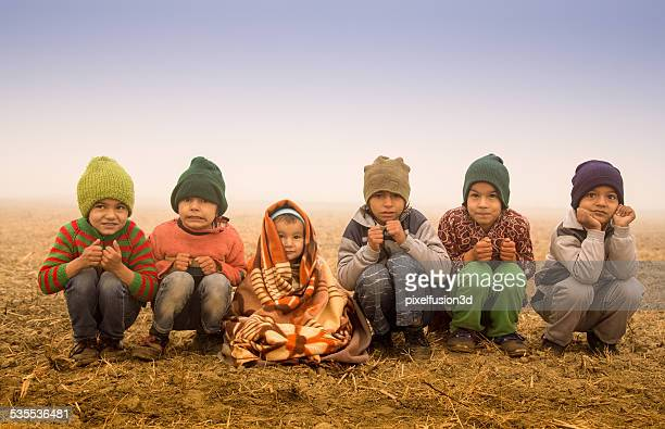 Poor Children Shivering in Winter Season