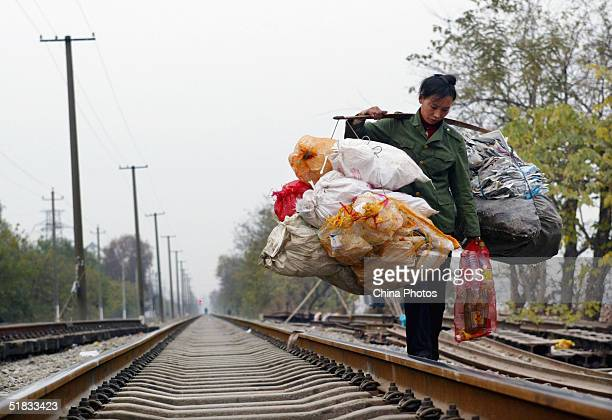 Poor Chinese Migrants Eek Out Living By Railroad