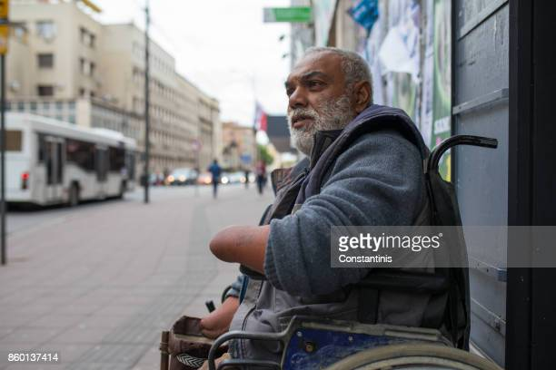 poor disabled man asked money on street - begging social issue imagens e fotografias de stock
