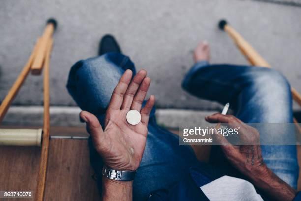 Armen deaktiviert Mann fragte Geld auf Straße