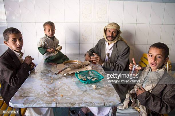 Poor familiy having a meager breakfast at a local cafe in Al Tawilah, San'a', Yemen. Yemen remains of the poorest countries in the Middle East and in...