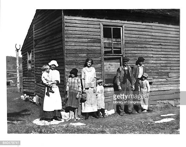 A poor illiterate rural family stand outside their house near Bowling Green Kentucky 1916 | Location near Bowling Green Kentucky USA