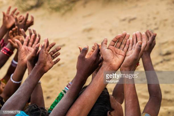 poor indian children asking for food, india - hungry stock pictures, royalty-free photos & images