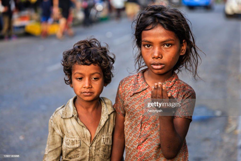 Poor Indian children asking for help : Stock Photo