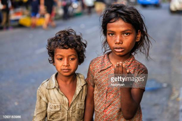 poor indian children asking for help - poverty stock pictures, royalty-free photos & images