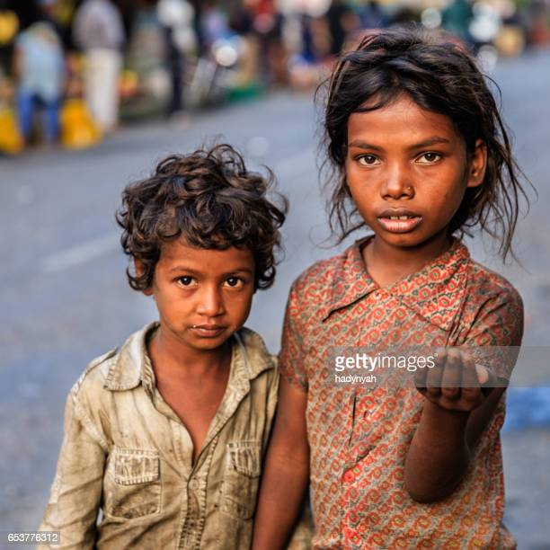 Poor Indian children asking for help
