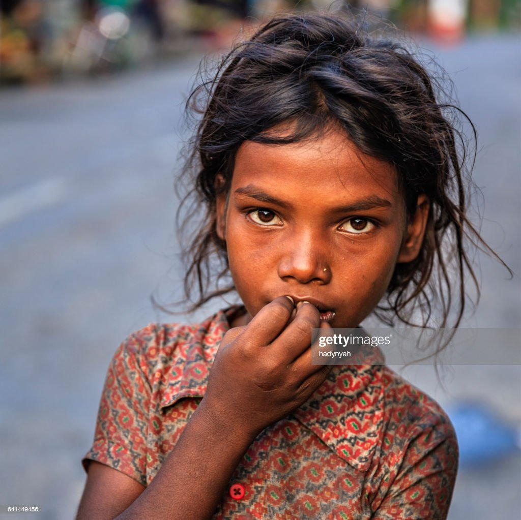 Poor Indian girl asking for help : Stock Photo