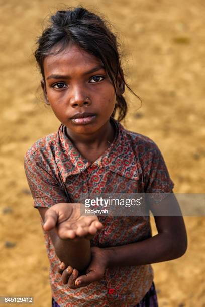 Poor Indian girl asking for help