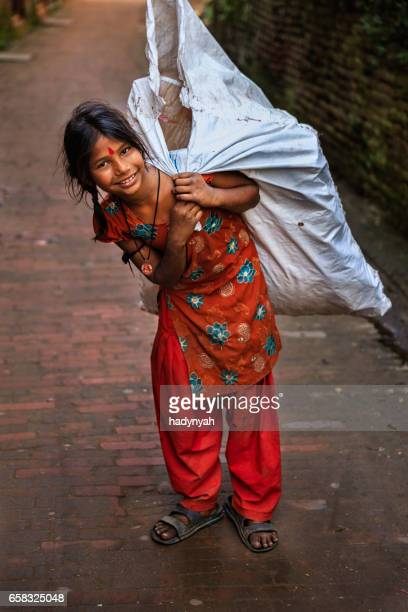 poor indian girl collecting plastic bottles for recycling - child labour stock pictures, royalty-free photos & images
