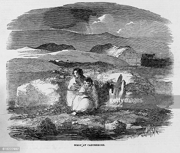 A poor Irish family in front of their scalp a sod house dug into the earth In 1849 citizens near Cahuermore still suffered under severe poverty...