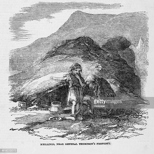 A poor Irish family in front of their scalp a sod house dug into the earth In 1849 citizens of Keillines still suffered under severe poverty despite...