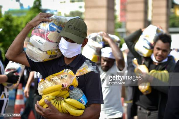 Poor man carries supplies at Praça da Estação on June 5, 2020 in Belo Horizonte, Brazil. About 3000 meals are being distributed every Friday, in...
