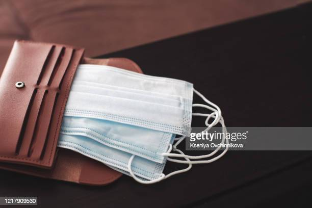 poor man hand hold empty wallet no money due to economic finance depression crisis after coronavirus outbreak went bankrupt with no cash money job unemployed need government support advice to pay bill - commercial activity stock pictures, royalty-free photos & images