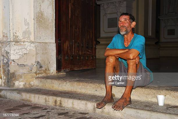 Poor man on church steps in Leon, Nicaragua