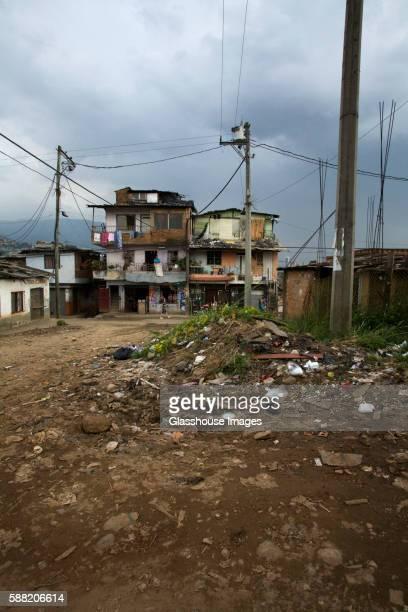 Poor Neighborhood With Pile of Garbage on Dirt Street, Medellin, Colombia