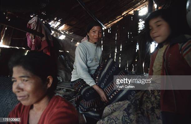 BOUSRA MONDOLKIRI CAMBODIA A poor Phnong family in their hut in northeastern Cambodia The Phnong are Cambodia's montagnards and live in an area close...