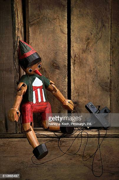 poor pinocchio - puppet stock pictures, royalty-free photos & images
