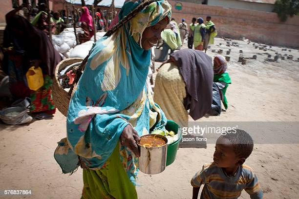 Poor Somalis gather free food at a feeding kitchen operated by the Non Government Organization SAACID SAACID has been running a food kitchen program...