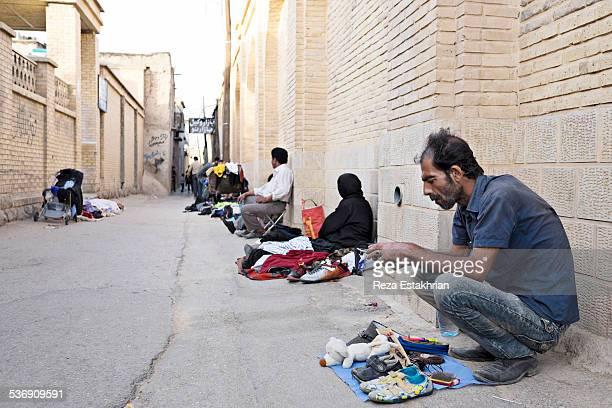 Poor street vendors eek out a living