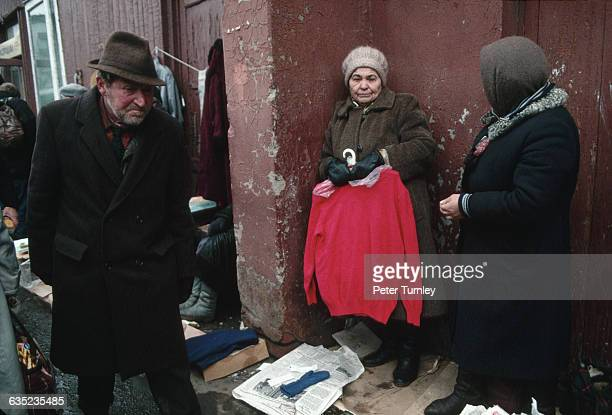 Poor Woman Selling Clothes on Street