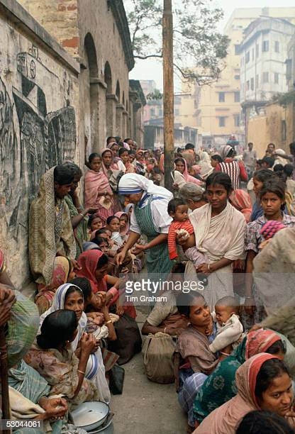 Poor women queuing for food at Mother Teresa's Mission in Calcutta India