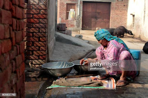 poor women washing clothes - salwar kameez stock photos and pictures