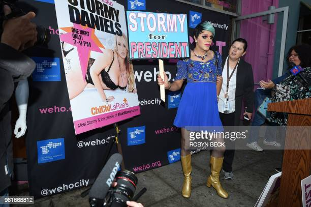 Pop artist and model Sham Ibrahim poses for the media shortly before a ceremony presenting adult film star Stormy Daniels with a key to the city of...