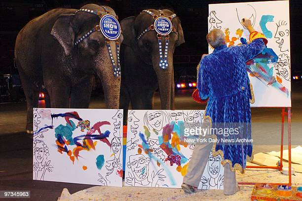 Pop artist James Rizzi adds touches to paintings made by Ringling Bros and Barnum Bailey Circus elephants Nicole and Kelly Ann for children of the...