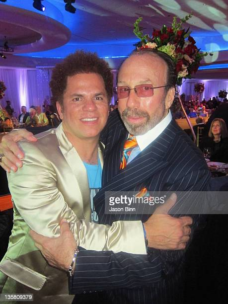 Pop Artist Romero Britto and producer Bernie Yuman pose during Miami Beach Best Buddies Annual Gala pose at the Fontainebleau on November 19 2011 in...