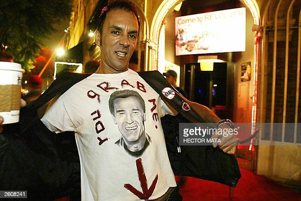 Pop Artist Tom de Mille displays a tshirt making reference to Arnold Schwarzeneggers misconduct with women queue to meet Gubernatorial candidate...
