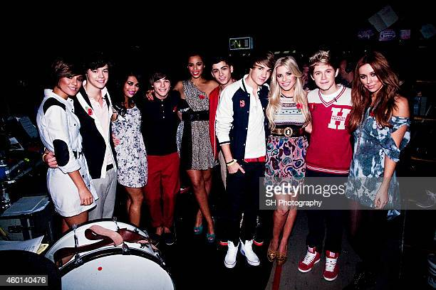 Pop band One Direction are photographed with girl band the Saturdays on November 6, 2010 in London, England.