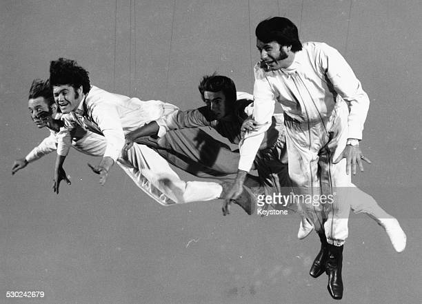 Pop band 'The Monkees' Davy Jones Mickey Dolenz Peter Tork and Mike Nesmith filming a flying sequence for the television show circa 1968