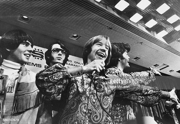 Pop band 'The Monkees' Davy Jones Mike Nesmith Peter Tork and Micky Dolenz celebrating at a press conference to advertise their concert Royal Garden...
