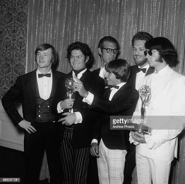Pop band 'The Monkees' holding their two Emmy Awards Peter Tork Micky Dolenz Davy Jones and Michael Nesmith at the ceremony in Los Angeles CA 1967