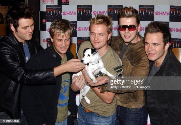 Pop band Westlife complete the final leg of their 36 hour launch tour for their new album 'Unbreakable' with dog 'Nipper' at HMV, Trocedero in...