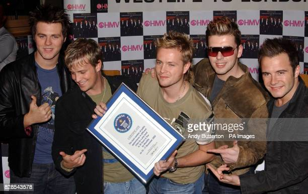 Pop band Westlife launch their new album 'Unbreakable' at HMV, Trocedero in London and receive the world record for the most public appearances in...