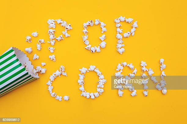 pop corn in a yellow background
