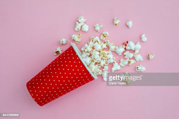 pop corn  in red   vase - popcorn stock pictures, royalty-free photos & images