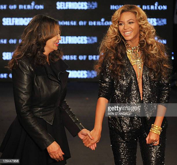 US pop diva Beyonce accompanied by her mother Tina Knowles smiles as she celebrates following her House of Dereon Spring/Summer 2012 collection show...