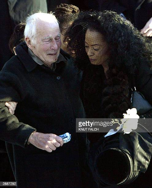 US pop diva Diana Ross and Norwegian Arne Naess attend the funeral of Ross' former husband and Naess' son Arne Naess Jr in Oslo 21 January 2004 Naess...