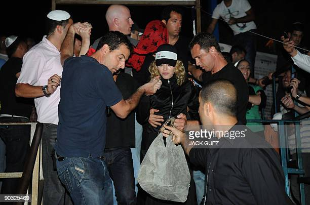 US pop diva Madonna exits the tomb of Ha'Ari Ha'Kadosh or Rabbi Isaac Luria BenShelomo at the ancient cemetery in the northern Israeli city of Safed...